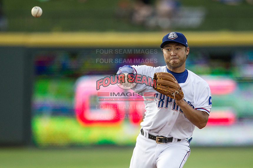 Round Rock Express second baseman Kensuke Tanaka (8) makes a throw to first base during the Pacific Coast League baseball game against the Fresno Grizzlies on June 22, 2014 at the Dell Diamond in Round Rock, Texas. The Express defeated the Grizzlies 2-1. (Andrew Woolley/Four Seam Images)