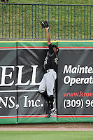 Kane County Cougars outfielder Trey Martin (25) scales the wall to bring back a Carson Kelly hit ball during a game against the Peoria Chiefs on June 2, 2014 at Dozer Park in Peoria, Illinois.  Peoria defeated Kane County 5-3.  (Mike Janes/Four Seam Images)