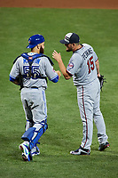 Minnesota Twins pitcher Glen Perkins celebrates with Toronto Blue Jays catcher Russell Martin after closing out the MLB All-Star Game on July 14, 2015 at Great American Ball Park in Cincinnati, Ohio.  (Mike Janes/Four Seam Images)