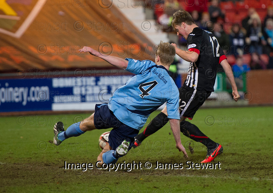 Pars' Jordan Moore scores their late equalising goal.