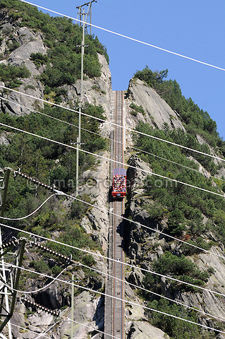 Switzerland, Western Europe, Grimsel region, nr. Guttannen, Gelmerbahn funicular. Passenger car descending. Note: No releases available. --- Info: The Gelmer cable car funicular railway with a maximum incline of 106 percent is Europe's steepest cable car. The Gelmer Railway was built in the 1920s to help with the construction of the Lake Gelmer water reservoir dam. Originally used for freight the cable car was converted to a passenger railway in 2001. The 12 minutes and one kilometer long ride in the open carriages overcomes a 450 meters height difference and takes one up to Lake Gelmer at an altitude of 1860 meters above sea level. The region where the reservoir is located is the starting point for hikes and mountain tours.