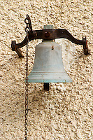 In the courtyard, the old bell with bell chain. Chateau Mourgues du Gres Grès, Costieres de Nimes, Bouches du Rhone, Provence, France, Europe