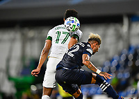 LAKE BUENA VISTA, FL - AUGUST 01: Jeremy Ebobisse #17 of the Portland Timbers and Ronald Matarrita #22 of New York City FC challenge for a header during a game between Portland Timbers and New York City FC at ESPN Wide World of Sports on August 01, 2020 in Lake Buena Vista, Florida.