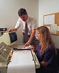 doctor or technicians reviewing digital EEG printout