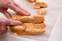 How to make foie gras duck's liver (series of images): Each lobe of the duck liver is cut once more Ferme de Biorne duck and fowl farm Dordogne France Workshop on how to make foie gras duck liver pate and other conserves