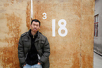 Chinese artist Qiu Anxiong seen here in outside of his studio in Shanghai, China on Tuesday, 13 March 2007.
