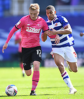 5th April 2021; Madejski Stadium, Reading, Berkshire, England; English Football League Championship Football, Reading versus Derby County; Louie Sibley of Derby County competes for the ball with Andy Rinomhota of Reading