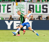 AUSTIN, TX - JUNE 19: Alex Ring #8 of Austin FC and Cristian Espinoza #10 of the SJ Earthquakes battle for control of the ball during a game between San Jose Earthquakes and Austin FC at Q2 Stadium on June 19, 2021 in Austin, Texas.