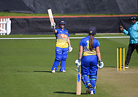 Otago's Katey Martin celebrates her half century during the Hallyburton Johnstone Shield women's cricket match between Wellington Blaze and Otago Sparks at the Basin Reserve in Wellington, New Zealand on Sunday, 14 March 2021. Photo: Dave Lintott / lintottphoto.co.nz