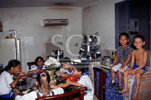 Sao Paulo, Brazil. Favela shanty town; family lunch.