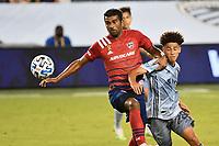 KANSAS CITY, KS - SEPTEMBER 02: Thiago Santos #5 of FC Dallas holds off Cameron Duke #28 of Sporting Kansas City during a game between FC Dallas and Sporting Kansas City at Children's Mercy Park on September 02, 2020 in Kansas City, Kansas.