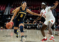 COLLEGE PARK, MD - DECEMBER 28: Kayla Robbins #5 of Michigan holds off Ashley Owusu #15 of Maryland. during a game between University of Michigan and University of Maryland at Xfinity Center on December 28, 2019 in College Park, Maryland.