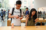 Shoppers check out new iPhone at the Apple Store in Tokyo's Omotesando shopping district in Japan on September 22, 2017. Apple Inc.'s new iPhone 8 and iPhone 8 Plus smartphones went on sale in Japan. (Photo by YUTAKA/AFLO)