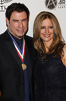 BEVERLY HILLS, CA - JANUARY 17: John Travolta, Kelly Preston at the 11th Annual Living Legends Of Aviation Awards held at The Beverly Hilton Hotel on January 17, 2014 in Beverly Hills, California. (Photo by Xavier Collin/Celebrity Monitor)