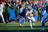 New York Jets wide receiver Quincy Enunwa (81) is tackled by Jordan Poyer (21) during an NFL football game against the Buffalo Bills, Sunday, December 9, 2018, in Orchard Park, N.Y.  (Mike Janes Photography)