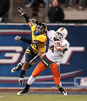 Darian Hagan breaks up a pass intended for Miami's Aldarius Johnson, .2008 Emerald Bowl, San Francisco, Calif., Saturday, Dec. 27, 2008. University of California 24, University of Miami, 17.
