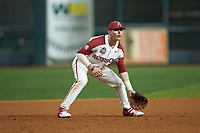Arkansas Razorbacks third baseman Cole Austin (16) on defense against the Baylor Bears in game nine of the 2020 Shriners Hospitals for Children College Classic at Minute Maid Park on March 1, 2020 in Houston, Texas. The Bears defeated the Razorbacks 3-2. (Brian Westerholt/Four Seam Images)