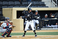 Patrick Frick (5) of the Wake Forest Demon Deacons at bat against the Illinois Fighting Illini at David F. Couch Ballpark on February 16, 2019 in  Winston-Salem, North Carolina.  The Fighting Illini defeated the Demon Deacons 5-2. (Brian Westerholt/Four Seam Images)
