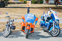 Motorcycles decorated with Trump campaign shirts stand parked as alt-right organization Super Happy Fun America demonstrates against facemasks, vaccines, and pandemic closures, and in support of the reelection of President Donald J. Trump near the residence of Massachusetts governor Charlie Baker in Swampscott, Massachusetts, on Sat., Sept. 26, 2020. Super Happy Fun America is most well known for organizing the Straight Pride Parade in Boston on August 31, 2019.