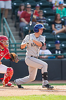 David Dahl (21) of the Asheville Tourists follows through on his swing against the Hickory Crawdads at L.P. Frans Stadium on April 13, 2014 in Hickory, North Carolina.  The Tourists defeated the Crawdads 5-4.  (Brian Westerholt/Four Seam Images)
