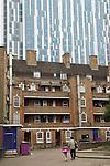 Nido student accomodation towering over traditional east London housing estate. Brune estate London E1. Tallest student accomocation in world.