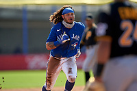Toronto Blue Jays Austin Martin (80) runs to third base after an overthrow while stealing second during a Major League Spring Training game against the Pittsburgh Pirates on March 1, 2021 at the TD Ballpark in Dunedin, Florida.  (Mike Janes/Four Seam Images)
