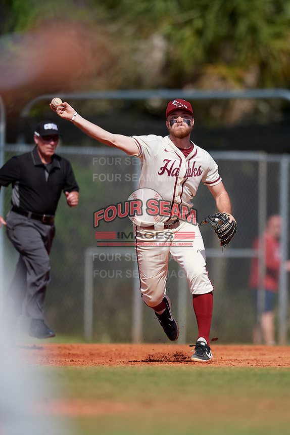 Saint Joseph's Hawks third baseman Nate Thomas (11) throws to first base during a game against the Ball State Cardinals on March 9, 2019 at North Charlotte Regional Park in Port Charlotte, Florida.  Ball State defeated Saint Joseph's 7-5.  (Mike Janes/Four Seam Images)