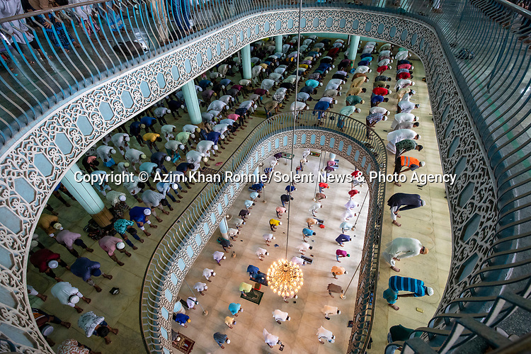 FRIDAY PRAYER: 28TH AUGUST.<br /> <br /> Thousands of people come together to pray over several floors of one of the biggest mosques in the world. Those taking part in group prayers can be seen neatly lined up side by side as they stand, sit, kneel and bow during prayers. Around 40,000 people were visiting the mosque - decorated in beautiful teal and gold - for weekly prayers. The National Mosque of Bangladesh, known as Baitul Mukarram or The Holy House in English, is one of the 10 biggest mosques in the world and can hold up to 100,000 people, including in the outside open space.<br /> <br /> Please byline: Azim Khan Ronnie/Solent News<br /> <br /> © Azim Khan Ronnie/Solent News & Photo Agency<br /> UK +44 (0) 2380 458800