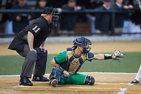 Notre Dame Fighting Irish catcher David LaManna (3) frames a pitch as home plate umpire Darrell Arnold looks on during the game against the Wake Forest Demon Deacons at David F. Couch Ballpark on March 10, 2019 in  Winston-Salem, North Carolina. The Fighting Irish defeated the Demon Deacons 8-7 in 10 innings in game two of a double-header. (Brian Westerholt/Four Seam Images)