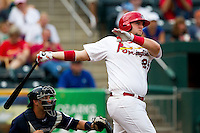 Matt Adams (25) of the Springfield Cardinals follows through his swing during a game against the Northwest Arkansas Naturals at Hammons Field on July 31, 2011 in Springfield, Missouri. Northwest Arkansas defeated Springfield 9-1. (David Welker / Four Seam Images)