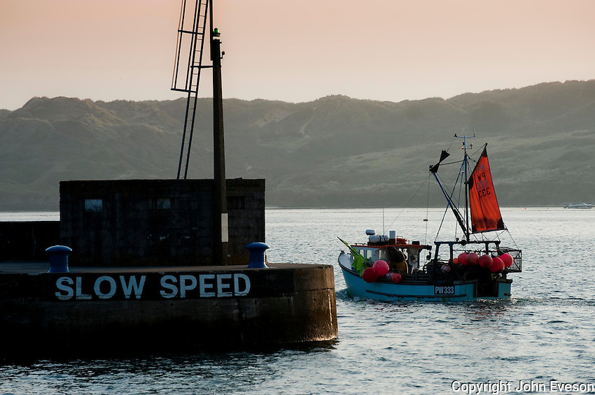 Fishing boat leaving the harbour at Padstow, Cornwall