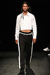 Model Pedro walks runway in an outfit from the Linder Spring Summer 2017 collection by Sam Linder and Kirk Millar on July 11 2016, during New York Fashion Week Men's Spring Summer 2017.