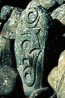 ".Carved ""mane"" stone, Kali Gandaki valley, west Nepal. A mane stone is a devotional object, carved by a devout Buddhist and placed in an auspicious site, such as near a gompa or monastery, or as part of a ""mane wall"" - a collection of many hundreds or thousands of such carvings.."
