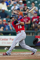 Oklahoma City RedHawks second baseman Jose Martinez (15) swings the bat during the Pacific Coast League baseball game against the Round Rock Express on July 9, 2013 at the Dell Diamond in Round Rock, Texas. Round Rock defeated Oklahoma City 11-8. (Andrew Woolley/Four Seam Images)