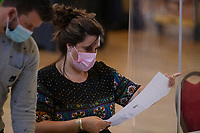 Pictured: A lady counts the ballot papers during the Swansea West and South West Wales Regional Election Count at Brangwyn Hall in Swansea, Wales, UK. Friday 07 May 2020