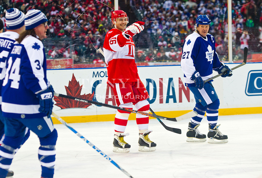 31 December 2013: Former Detroit Red Wings forward Sergei Fedorov (91) points and laughs on the ice during the Toronto Maple Leafs v Detroit Red Wings Alumni Showdown hockey game, at Comerica Park, in Detroit, MI.