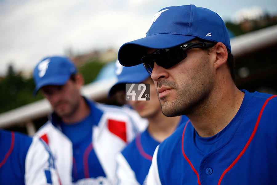 25 June 2011: Vincent Ferreira of Team France. Illustration of a photographic essay called Life in the dugout, during Czech Republic 11-1 win over France, at the 2011 Prague Baseball Week, in Prague, Czech Republic.