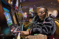 A woman plays the slot machines at the Motorcity Casino in Detroit, Michigan.