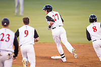 Trey Michalczewski (27) of the Kannapolis Intimidators is chased by teammates Zachary Voight (8), Kale Kiser (9) and Adam Engel (23) after driving in the winning run in the bottom of the 10th inning against the Hickory Crawdads at CMC-Northeast Stadium on May 18, 2014 in Kannapolis, North Carolina.  The Intimidators defeated the Crawdads 6-5 in 10 innings.  (Brian Westerholt/Four Seam Images)