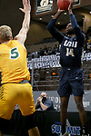 SIOUX FALLS, SD - MARCH 9: DeShang Weaver #14 of the Oral Roberts Golden Eagles shoots a jumper against the North Dakota State Bison during the 2021 Men's Summit League Basketball Championship at the Sanford Pentagon in Sioux Falls, SD. (Photo by Dave Eggen/Inertia)