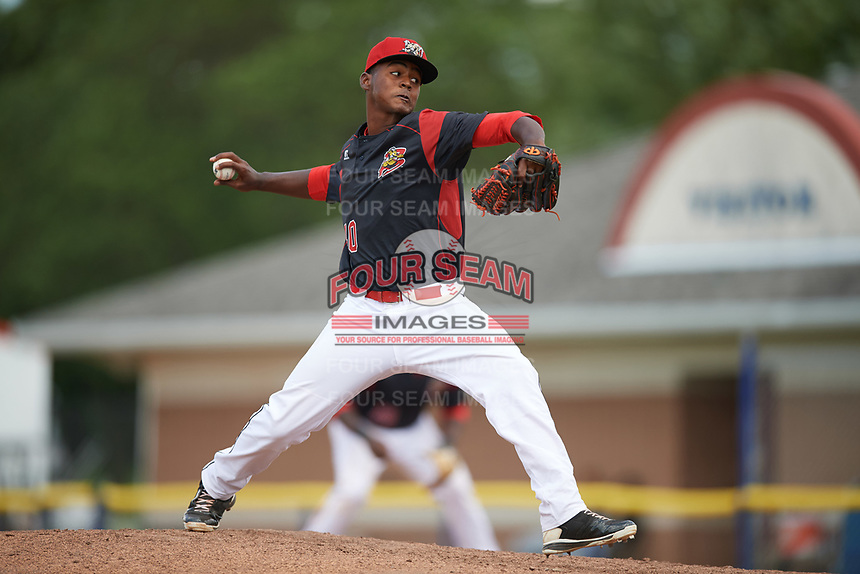 Batavia Muckdogs relief pitcher Eliezer Cuello (40) delivers a pitch during a game against the West Virginia Black Bears on June 25, 2017 at Dwyer Stadium in Batavia, New York.  West Virginia defeated Batavia 6-4 in the completion of the game started on June 24th.  (Mike Janes/Four Seam Images)