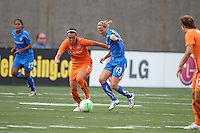 Meghan Schnur and Kristine Lilly fight for the ball