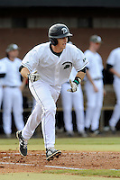 Left fielder Stephen Dowling (7) of the University of South Carolina Upstate Spartans runs toward first in a game against the Winthrop University Eagles on Wednesday, March 4, 2015, at Cleveland S. Harley Park in Spartanburg, South Carolina. Upstate won, 12-3. (Tom Priddy/Four Seam Images)