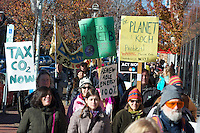 Climate activists march from Harvard Square to the Statehouse in Boston MA,  part of world wide climate actions with 785,000 people in 2300 events in175 countries before the Paris climate conference 11.29.15