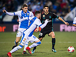 Marco Asensio Willemsen (R) of Real Madrid fights for the ball with Roberto Roman Triguero (C) and Gerard Gumbau Garriga of CD Leganes during the Copa del Rey 2017-18 match between CD Leganes and Real Madrid at Estadio Municipal Butarque on 18 January 2018 in Leganes, Spain. Photo by Diego Gonzalez / Power Sport Images