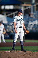 Everett AquaSox relief pitcher Nolan Hoffman (14) looks in for the sign during a Northwest League game against the Tri-City Dust Devils at Everett Memorial Stadium on September 3, 2018 in Everett, Washington. The Everett AquaSox defeated the Tri-City Dust Devils by a score of 8-3. (Zachary Lucy/Four Seam Images)