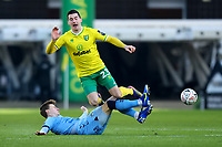9th January 2021; Carrow Road, Norwich, Norfolk, England, English FA Cup Football, Norwich versus Coventry City; Ben Sheaf of Coventry City tackles and upends Kenny McLean of Norwich City