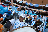 Argentina fans cheer and band drums at Soccer City in Johannesburg, South Africa on Thursday, June 17, 2010 during Argentina's and South Korea FIFA World Cup first round match.
