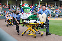 "Mascot Reedy Rip'It of the Greenville Drive is one of the ""victims"" in the gurney race on First Responders Appreciation Day during a game with the Lexington Legends on Sunday, July 21, 2013, at Fluor Field at the West End in Greenville, South Carolina. Lexington won, 2-0. (Tom Priddy/Four Seam Images)"