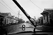 New Orleans, Louisiana.USA.July 27, 2006..A tire marks a hole in the street of a district that was flooded nearly one year after hurricane Katrina hit and the levees broke leaving 80% of the city flooded..